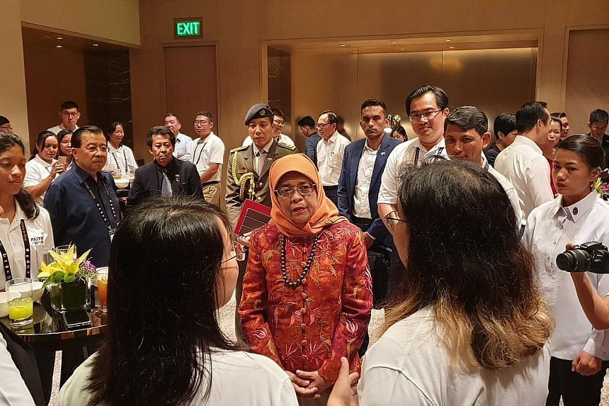President Halimah Yacob meeting participants of Faiths@Work, a regional network that brings together South-east Asians of different faiths to do humanitarian work, in Manila yesterday. Dialogue is essential to counter prejudice, intolerance and ignor