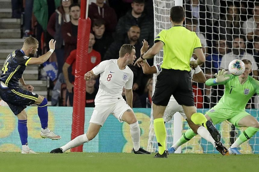 Kosovo's Valon Berisha scoring his side's second goal against England in Tuesday's Euro 2020 qualifier at St Mary's Stadium in Southampton. The Three Lions still ran out 5-3 winners and top Group A with 12 points from four games but their sloppy defe
