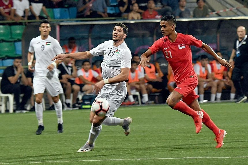 Defender Safuwan Baharudin (right) came through for the Lions on Tuesday after scoring the winning goal in their 2-1 victory over Palestine at the Jalan Besar Stadium. ST PHOTO: KHALID BABA