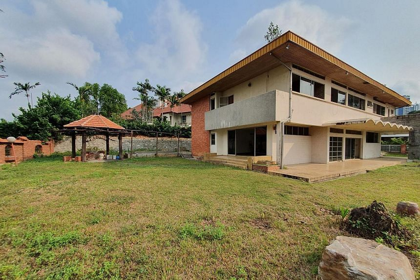 The two-storey bungalow is located within the Chatsworth Park good class bungalow area and has a total area of 19,333 sq ft. It is positioned on elevated ground in a low-rise area. PHOTO: JLL