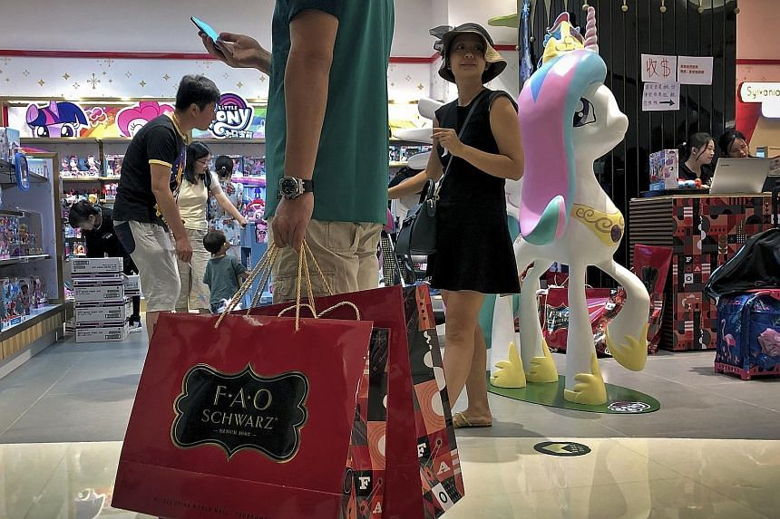 Shoppers at a Beijing outlet of US toy store chain FAO Schwarz in June. Over a quarter of American firms polled said they had redirected investments originally planned for China to other locations. PHOTO: ASSOCIATED PRESS
