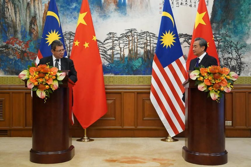 Chinese State Councillor Wang Yi told a news conference with Malaysian Foreign Minister Saifuddin Abdullah that this year, tensions in the South China Sea had dropped.