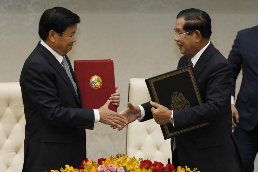 Cambodian Prime Minister Hun Sen (right) and his visiting Lao counterpart, Mr Thongloun Sisoulith, agreed in a statement to complete the process now that 86 per cent of the border has been marked.