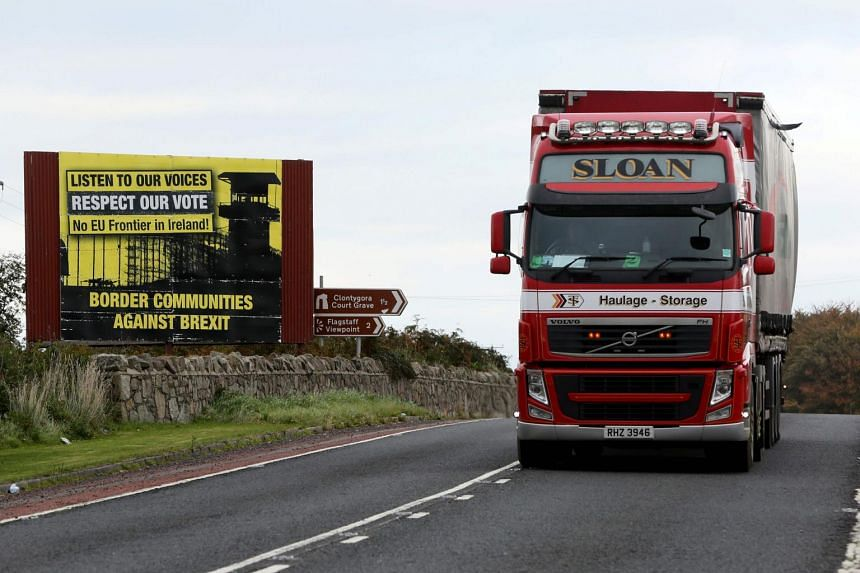 A truck passing by a post-Brexit anti-border poster between Newry in Northern Ireland and Dundalk in the Irish Republic, on Oct 9, 2018.