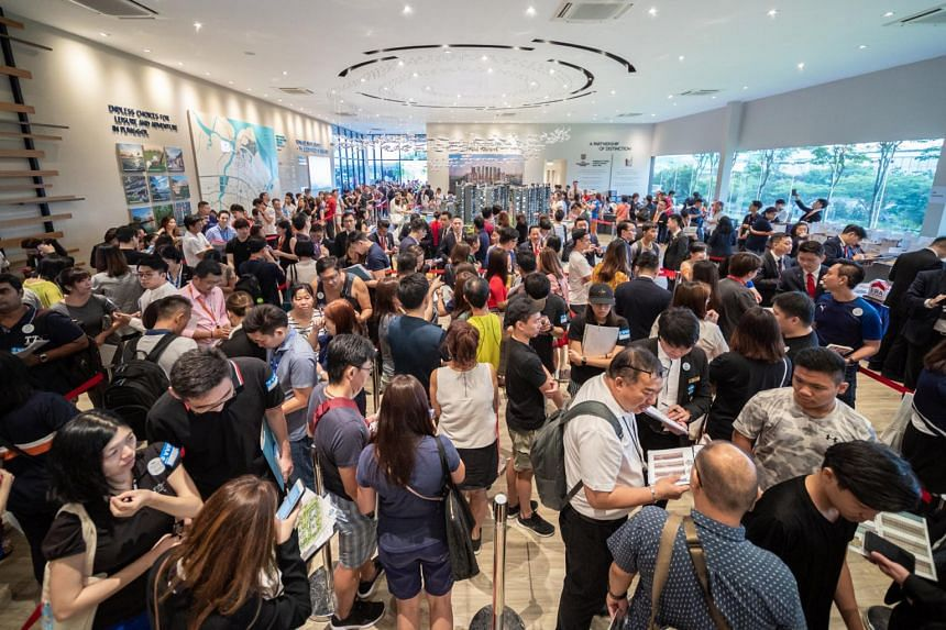 Crowds at a sales gallery for an executive condominium in Punggol during its launch weekend, on July 28, 2019.