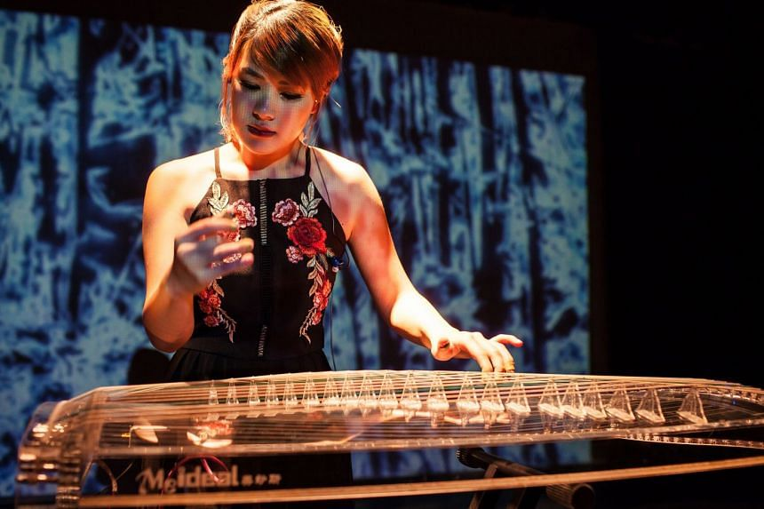 Malaysian guzheng player Sara Heng (above) and China's Taishan Shadow Puppet Art Troupe, led by Fan Wei Guo, are among the acts at this year's Moonfest.