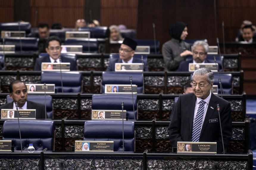 In a photo taken on July 10, Malaysian Prime Minister Mahathir Mohamad speaks at Dewan Rakyat, the lower house of the Parliament of Malaysia, in Kuala Lumpur.