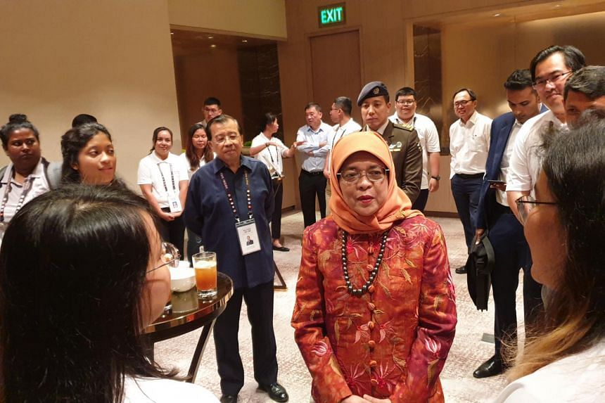 President Halimah met more than 20 young participants on from Faiths@Work, a regional network that brings together people of different religions to do good work, on Sept 11.