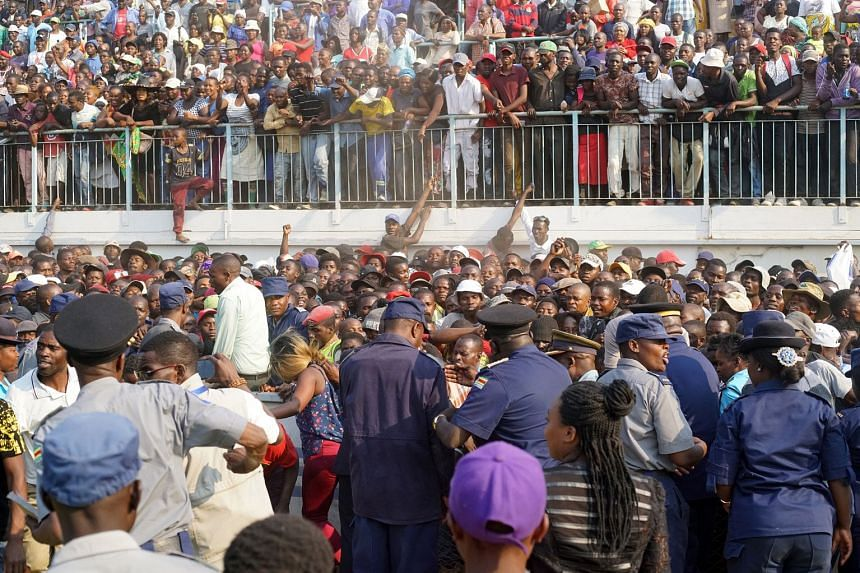 Crowds attend the funeral parade at Rufaro Stadium.