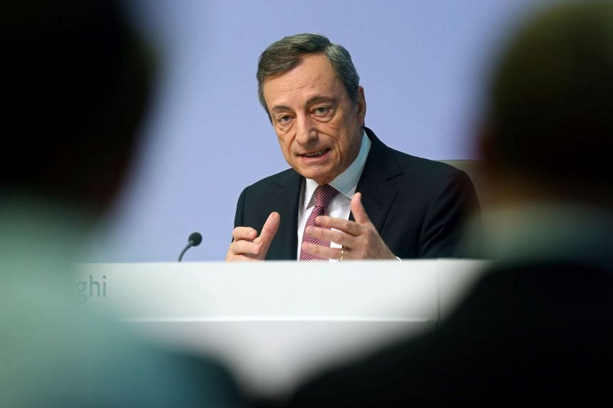 European Central Bank president Mario Draghi gestures as he speaks at a news conference.