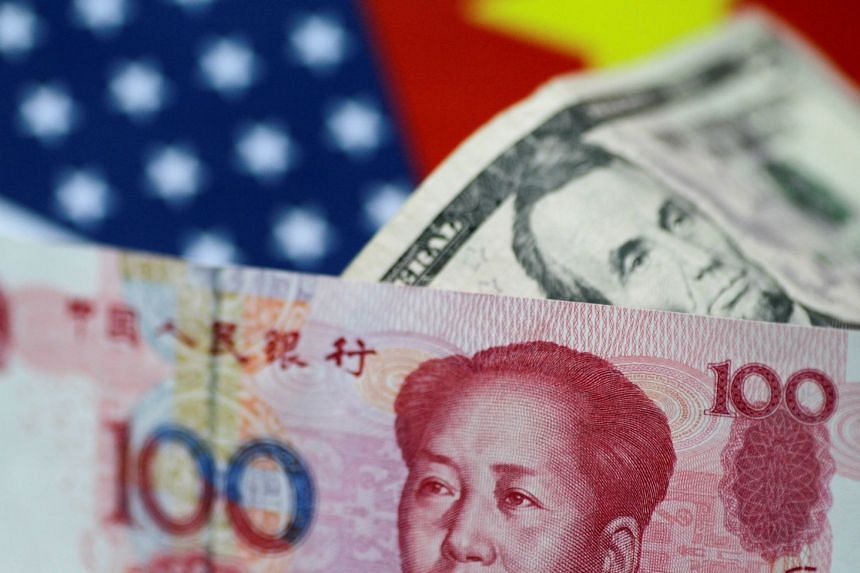 US dollar and China yuan notes are seen in this picture illustration.