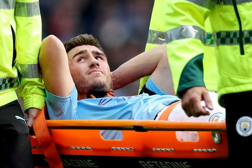 Manchester City's Aymeric Laporte is stretchered off after sustaining an injury against Brighton.