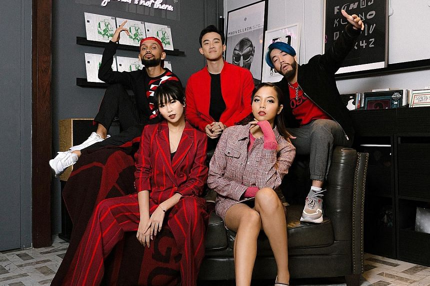Seated, from far left: Estelle Fly and Aisyah Aziz. Back row, from far left: TheLionCityBoy, DJ Myrne and Shigga Shay.