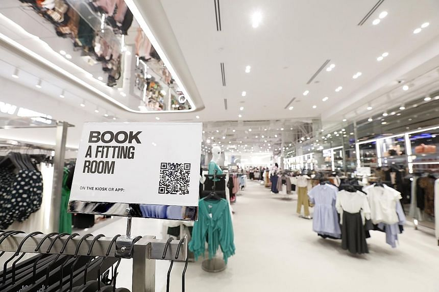Shoppers within 1km radius of the Pomelo store at 313@Somerset can book a fitting room with its mobile app, so they can continue browsing while waiting for their turn. Pomelo opened its first branch in Singapore on June 12 this year. ST FILE PHOTO