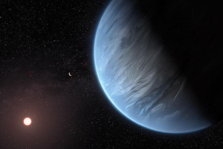 An artist's impression of the planet K2-18b, its host star and an accompanying planet in its system. Scientists have found that K2-18b is bathed in the right amount of warmth to allow for liquid water on its surface. PHOTO: EPA-EFE