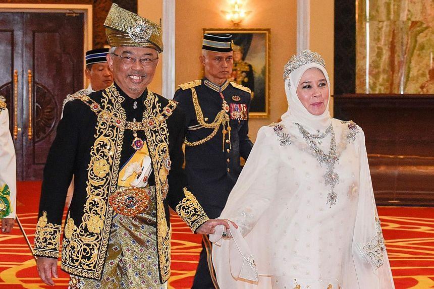 Malaysia's King, Sultan Abdullah Ri'ayatuddin, with his consort, Tunku Azizah Aminah Maimunah Iskandariah, during his coronation on July 30. PHOTO: AGENCE FRANCE-PRESSE
