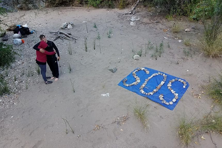"""The trapped trio crafted an SOS sign with rocks (above). Mr Whitson scratched """"HELP!"""" on his water bottle in the hope that somebody would find it."""