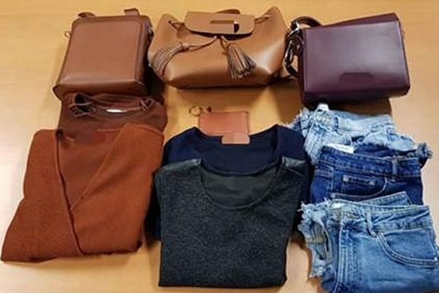 The women, aged 26 and 60, are believed to have used the victim's credit card to spend more than $1,500 on various goods, such as clothes, toiletries, handbags, healthcare products, a pair of spectacles and two stored-value cards.