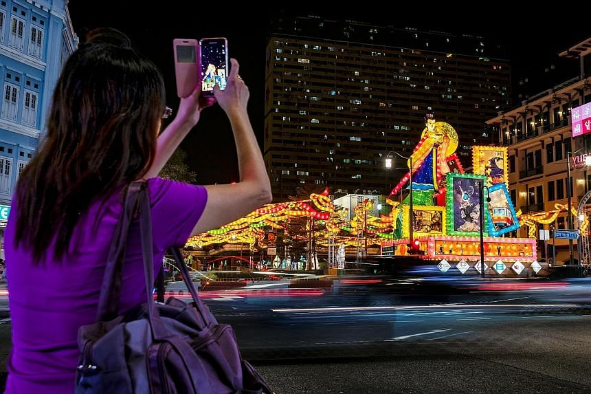 Giant lanterns depicting Chang'e, the goddess of the moon in Chinese mythology, and illuminated stamps light up a traffic junction in Chinatown. The lanterns, which line New Bridge Road, Eu Tong Sen Street and South Bridge Road, are part of the stree