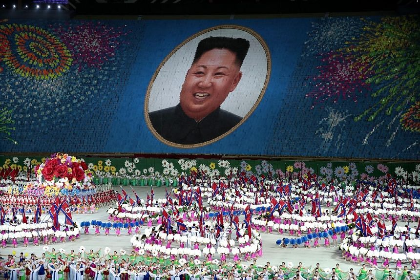 "Performers holding up cards to form a portrait of North Korean leader Kim Jong Un during a Mass Games performance titled ""The Land of the People"" at the May Day Stadium in Pyongyang on Wednesday. The Mass Games performances, which North Korea has sta"