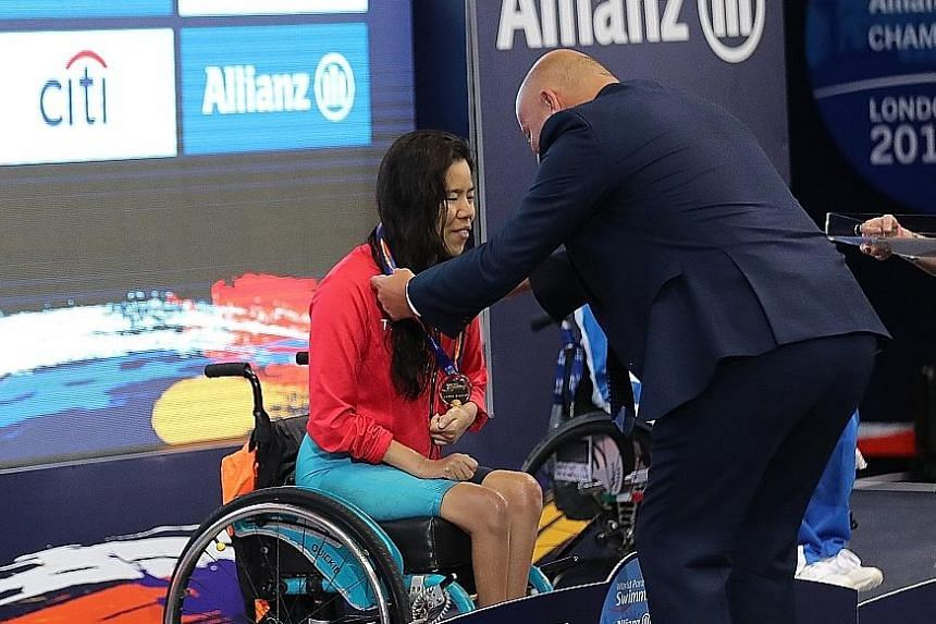 Left and below: Yip Pin Xiu finishing more than 20 seconds ahead of silver medallist Aly van Wyck-Smart of Canada in the women's 100m backstroke S2 at the World Para Swimming Championships in London on Wednesday. It was her second world title after h