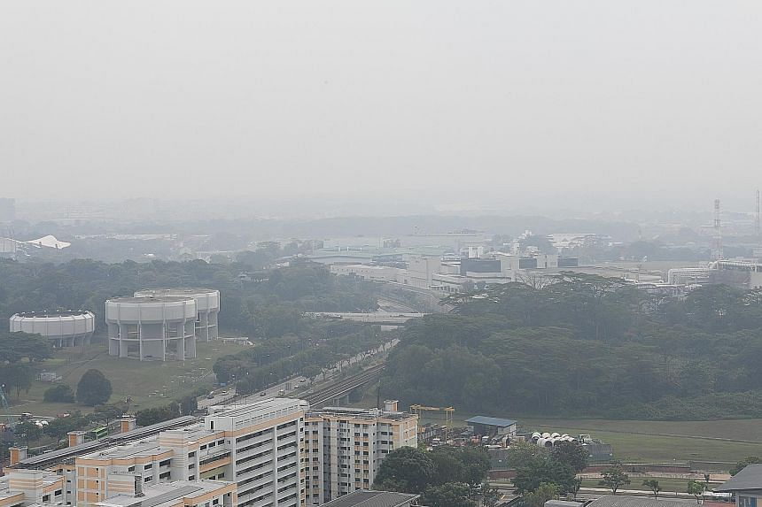 Haze in Woodlands and Kranji at 4.15pm yesterday. The air quality is forecast to be in the moderate range today. ST PHOTO: KHALID BABA