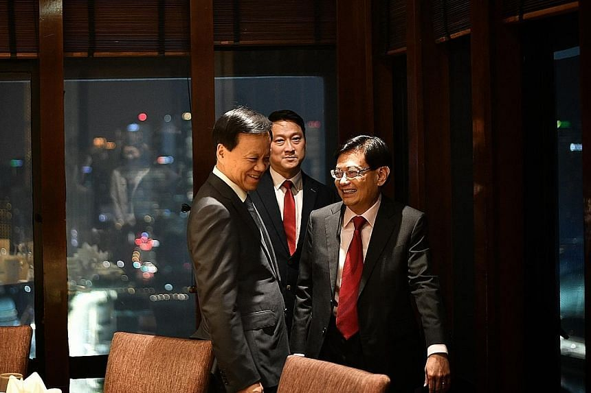 Chongqing party secretary and Chinese Communist Party Politburo member Chen Min'er (left) yesterday evening met Deputy Prime Minister Heng Swee Keat, who hosted him to dinner at the Peach Garden restaurant at OCBC Centre. Mr Chen, a rising political