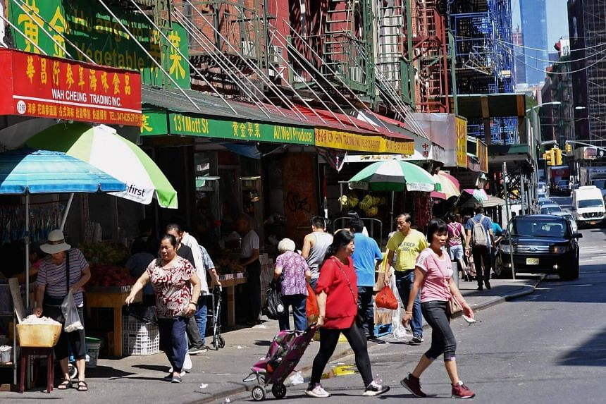 People walk through Chinatown on Aug 20, 2019 in New York City.