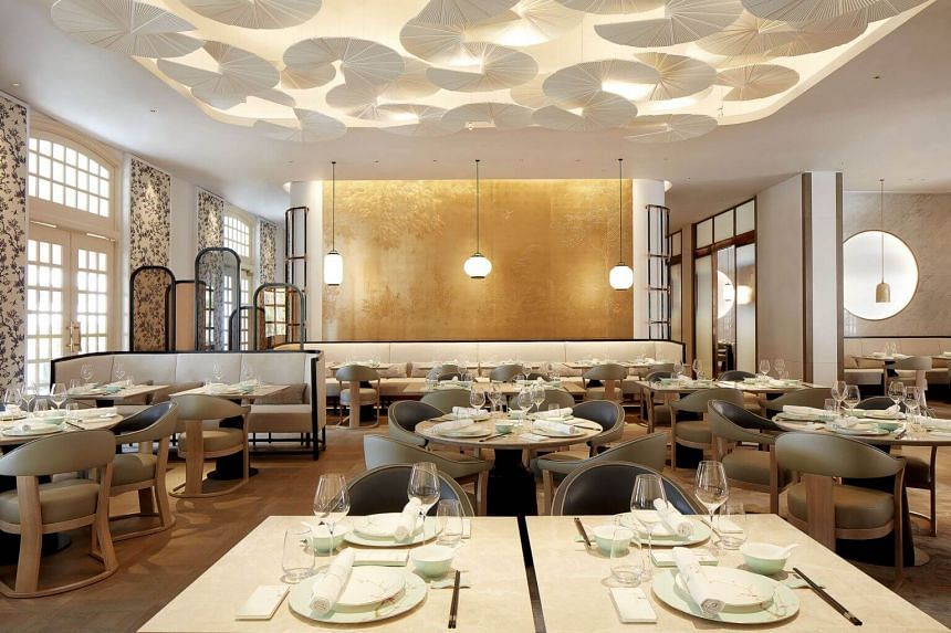 The spacious, no expense-spared, elegant dining room at Yì By Jereme Leung restaurant at Raffles Arcade.