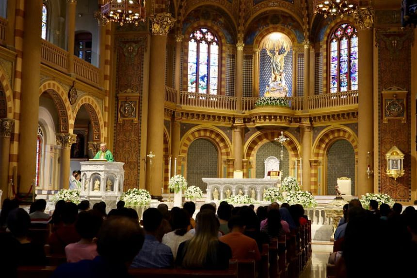 Catholic churchgoers attend a Mass in Bangkok on Sept 8, 2019.