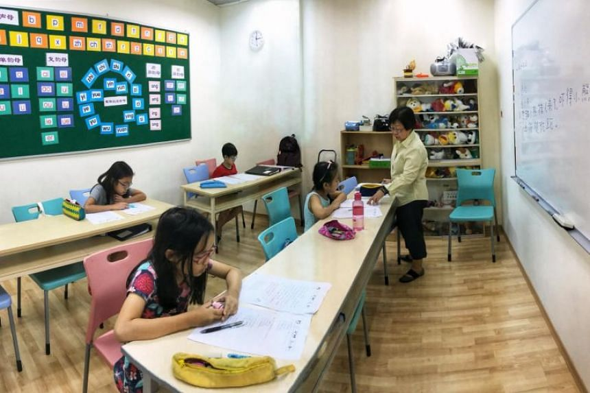 In a picture taken on Oct 29, 2017, children attend a Chinese class at Han Language Centre in Eastpoint Mall.