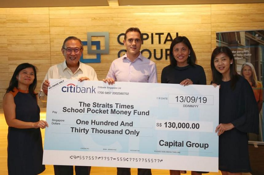 (From left) Ms Tan Bee Heong, general manager of The Straits Times School Pocket Money Fund (STSPMF); Dr Gerard Ee, treasurer of STSPMF; Mr Jonathan Wright, vice-president of Capital International Investors; Ms Katherine Wee, partner of Capital Resea