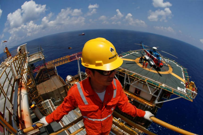 A photo taken on April 29 shows a Rosneft Vietnam employee at the Lan Tay gas platform in the South China Sea off the coast of Vung Tau, Vietnam.