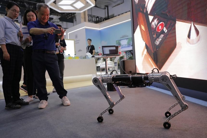 Visitors look at a quadruped robot at the World Artificial Intelligence Conference in Shanghai, on Aug 30, 2019.