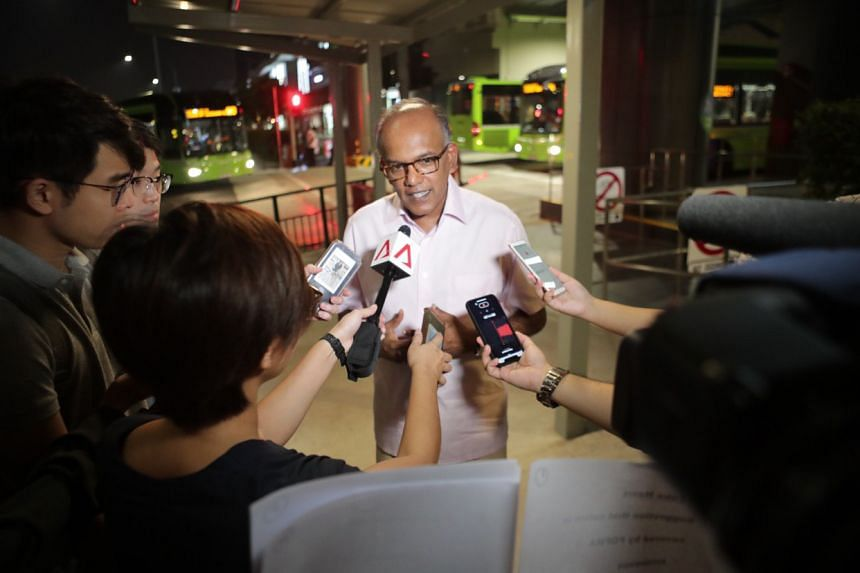"""Law and Home Affairs Minister K. Shanmugam speaks to the media on Sept 13 about a recent Facebook post by the Media Literacy Council which was widely criticised for calling satire a type of """"fake news""""."""