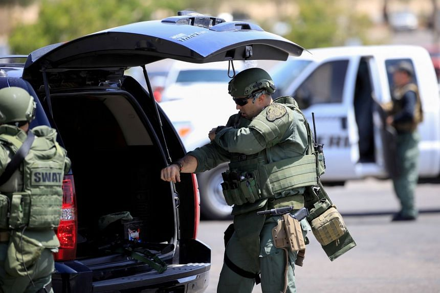 """Police Swat team members prepare after a mass shooting in El Paso, Texas. """"Swatting"""" is a form of retaliation in which someone reports a false emergency to get the authorities, particularly a Swat team, to descend on an address."""
