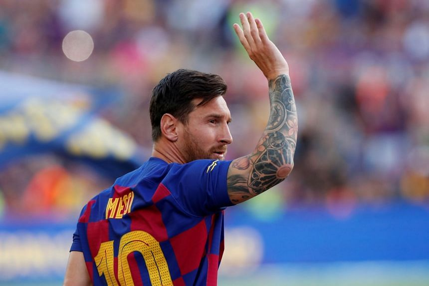 Barcelona's Lionel Messi waves to fans before a match.