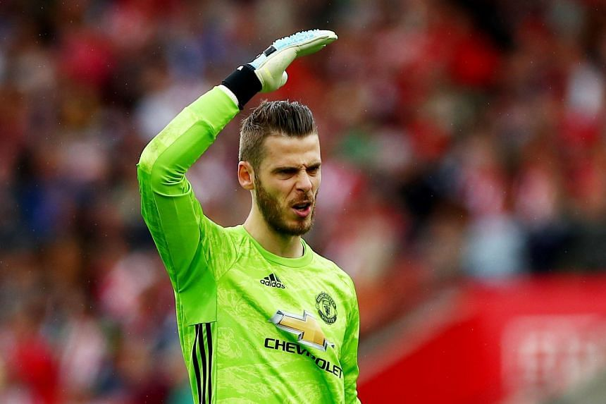 Manchester United's David de Gea reacts during a match.