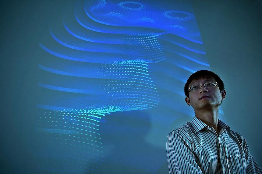 Assistant Professor Yang Shengyuan of the Singapore University of Technology and Design with an illustration of the 3D quantum Hall effect in the background. His team was involved in the first experimental demonstration of the effect in 3D - which pa