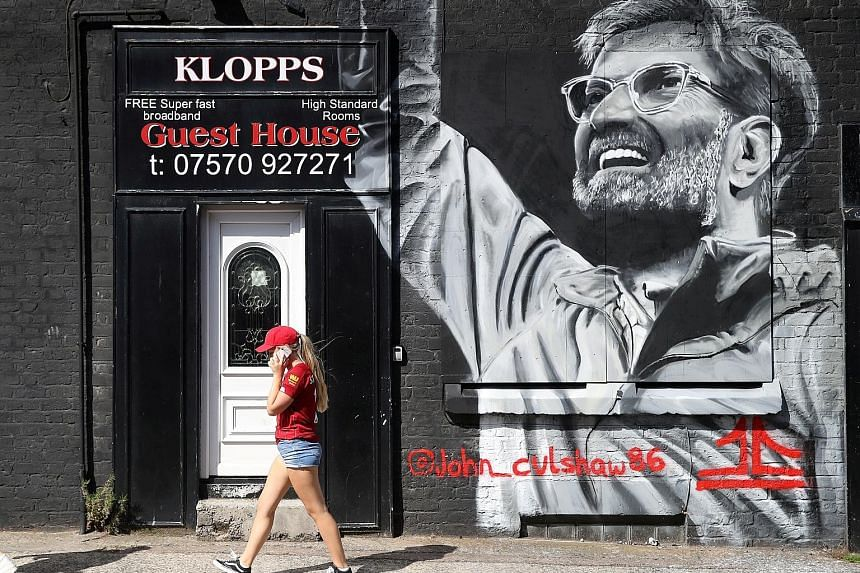 Liverpool manager Jurgen Klopp's mural is seen on the walls of a guest house near Anfield stadium. Under the stewardship of the German, Anfield has become a fortress with Liverpool unbeaten there for the last 40 league matches. PHOTO: REUTERS