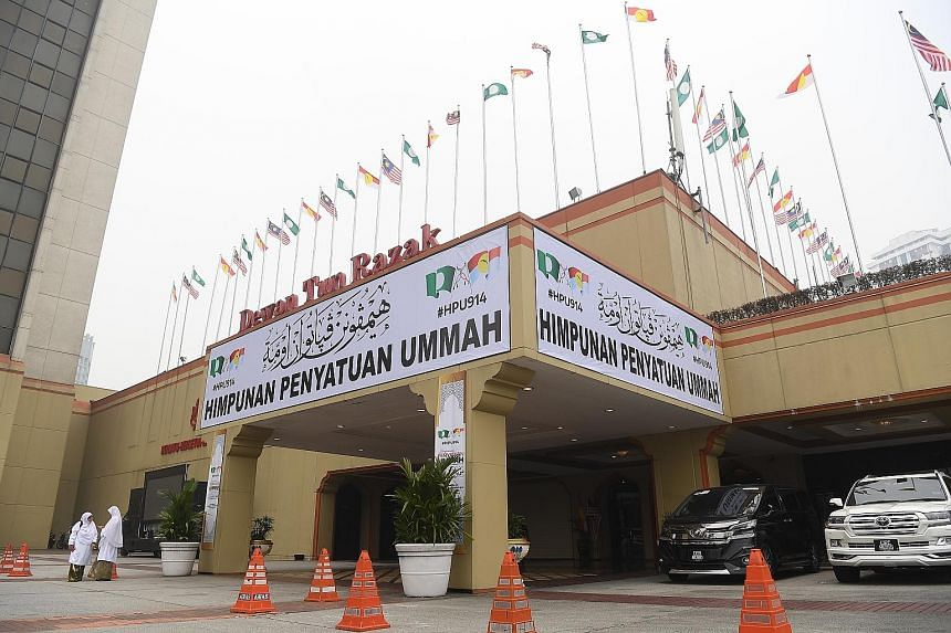 "The ""Himpunan Penyatuan Ummah"" or ""Unity Gathering of the Muslim Faithful"" organised by Umno and PAS kicked off in Kuala Lumpur yesterday with a series of town halls and rallies that claimed the Malays and their religion were being sidelined by the p"