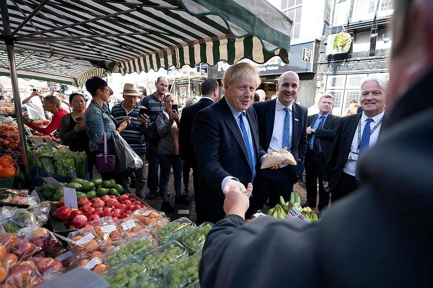 Britain's Speaker of Parliament John Bercow (above) has warned Prime Minister Boris Johnson not to disobey the law by refusing to ask the European Union for a Brexit delay. Mr Johnson (fourth from right, at a visit to Doncaster Market in Doncaster, y