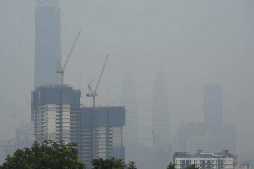 The Petronas Twin Towers in Kuala Lumpur is shrouded with haze on Sept 14, 2019.