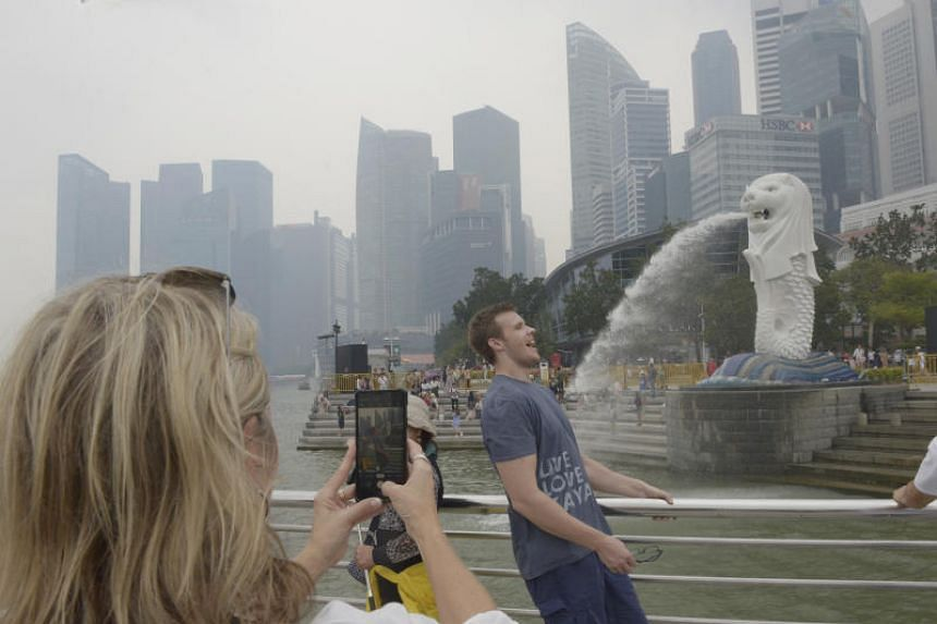 A photo taken near the Merlion Park shows haze over the area at around 2.40pm on Sept 14, 2019.