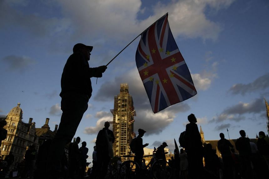 An anti-Brexit protester with a composite Union Jack and EU flag outside the Houses of Parliament in central London, on Sept 4, 2019.