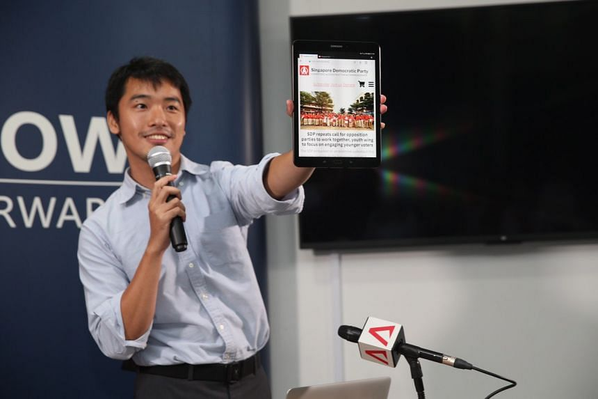 Software engineer Stanley Goh, a party volunteer, speaking about features of the new Singapore Democratic Party website during a media briefing on Sept 14, 2019.