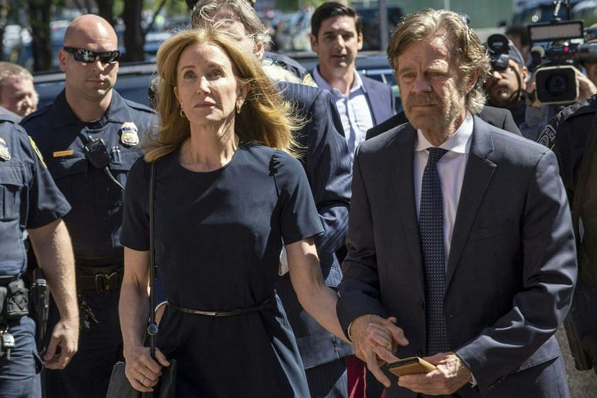 Huffman, escorted by her husband William H. Macy, makes her way to the court entrance.