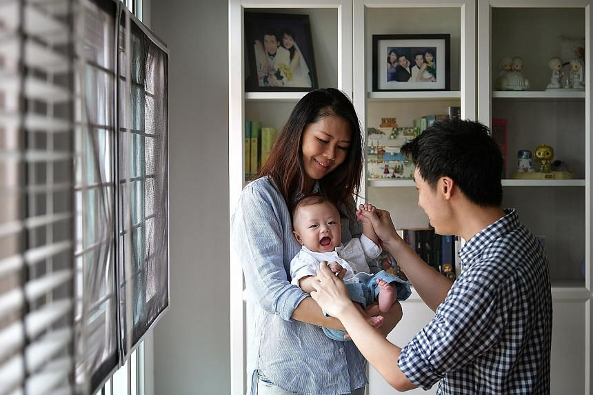 Ms Chen Li Jia with her son Hansel and her husband Darren Kuek at home. The couple welcomed Hansel in April this year after 14 years of marriage. Ms Chen, who went through several failed IVF attempts and miscarriages over the years, said it helped to