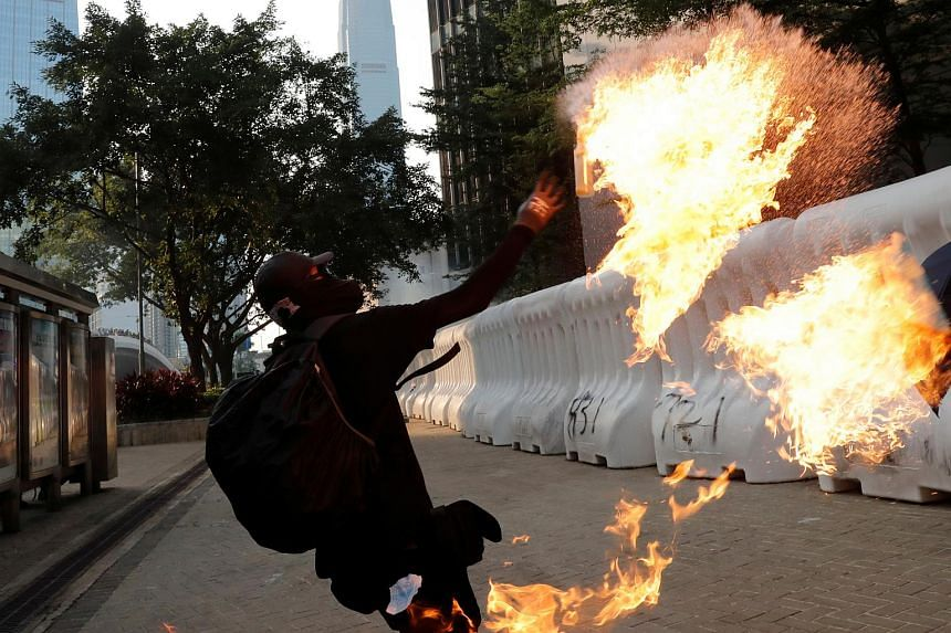 An anti-government protester throwing a Molotov cocktail during a demonstration near Central Government Complex in Hong Kong on Sept 15, 2019.