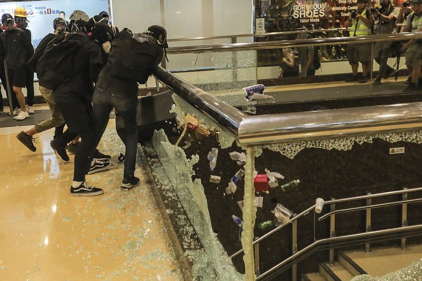 Protesters vandalising a glass balustrade at a mall during an anti-government rally in Hong Kong on Sept 15, 2019.